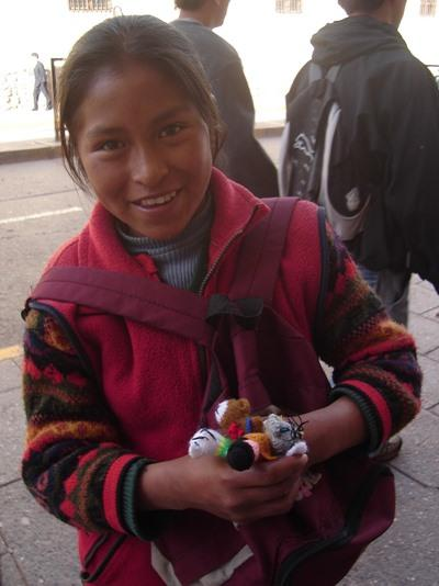 Local girl selling artisan goods on the street in Cochabamba, Bolivia