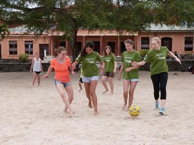 Projects Abroad volunteers play beach soccer on the Galapagos Islands