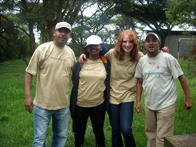 Female volunteer stands outside with Projects Abroad staff in Addis Ababa, Ethiopia