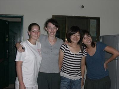 Female volunteers from different countries pose together in their shared apartment in Cambodia