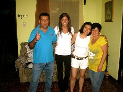 Projects Abroad Costa Rica volunteer poses for a picture with her host family.