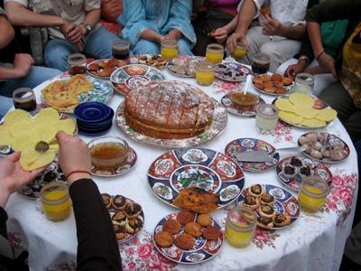 Host Family in Morocco prepares traditional dishes for volunteers
