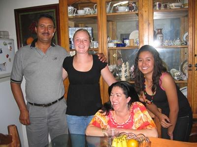 Volunteer with her host family in their home in Guadalajara, Mexico