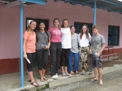 Volunteers taking a break from work in Nepal, Asia
