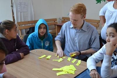 Local children get some help from a Journalism intern in Romania