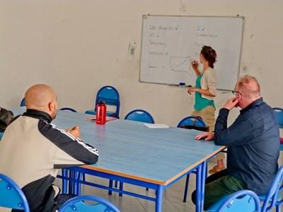 Volunteer teaches older students at an institution in Morocco