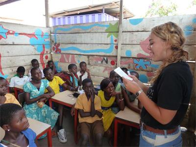 Teaching volunteer does educational activities with school children abroad