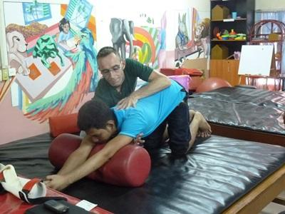 Treating children on the Physical Therapy project in Cambodia