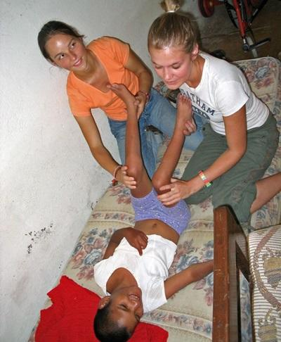 Medicine volunteer works with staff to help a child in Bolivia