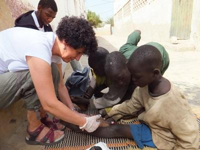 Nursing volunteer in Senegal works with children on the street