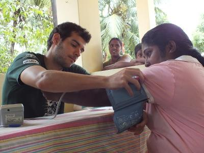 A local Sri Lankan woman gets her blood pressure checked by an intern in Sri Lanka.