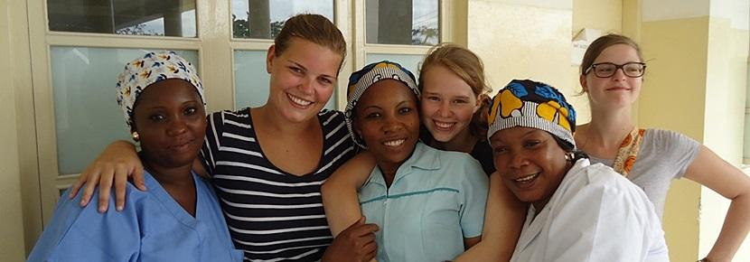 Volunteer with staff at a Midwifery project placement overseas with Projects Abroad
