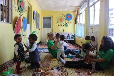 A Care volunteer at work in an orphanage in Ethiopia.