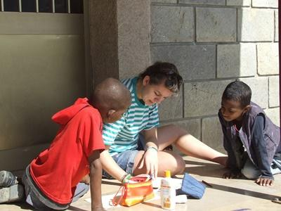 Volunteer doings arts & crafts with kids in a care center in Ethiopia, Africa