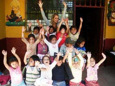 Volunteer in a classroom with children in a care center in Peru