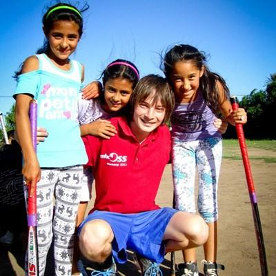 Volunteer coaches sports to school children in Argentina
