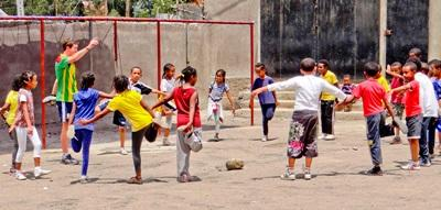 Volunteers stretching with students on the sports project in Ethiopia