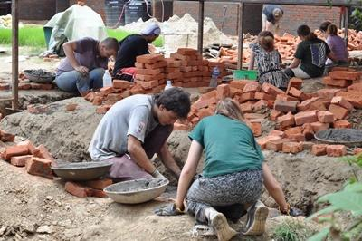 Projects Abroad Disaster Relief volunteers at work at a school in Nepal, Asia