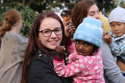 A female volunteer and a child at the Care & Community project in Nepal.