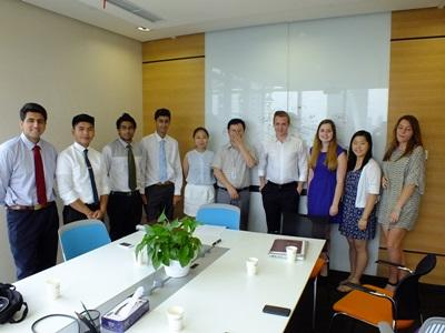 A group of Law & Business volunteers after a meeting with local businessmen in China