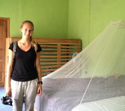 Projects Abroad volunteer in her bedroom at her host family in Ghana, Africa
